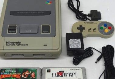 Super NES con controller e giochi