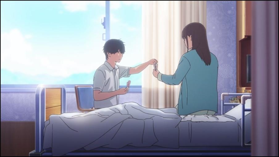 Sakura e Haruki giocano a carte in ospedale