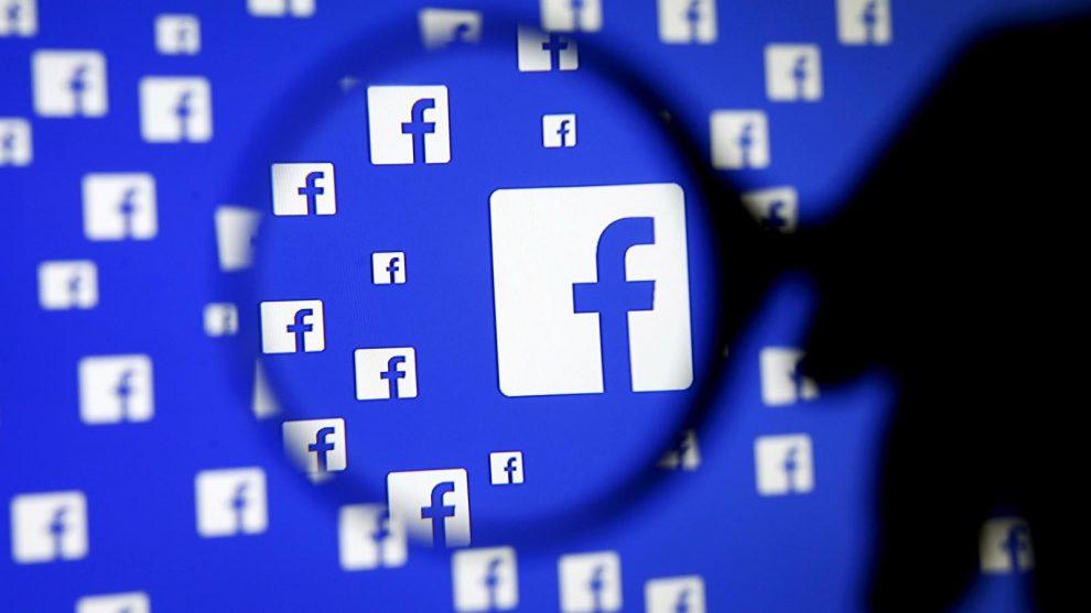 Facebook logo ingrandito da lente